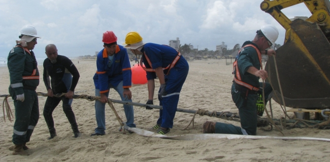 Workers install the EllaLink fiber optic cable at the South American landing site in Fortaleza, Brazil.