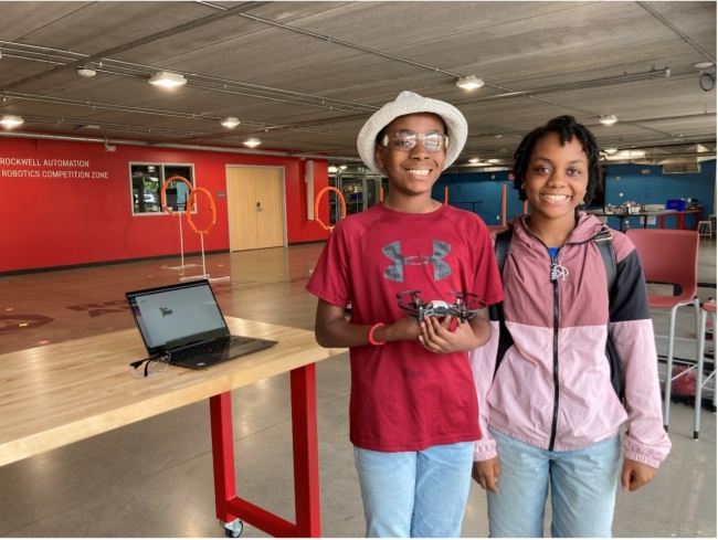 (L-R) Isaiah Brown and his sister, Raechel, learn to code and fly drones at an MSOE summer program.
