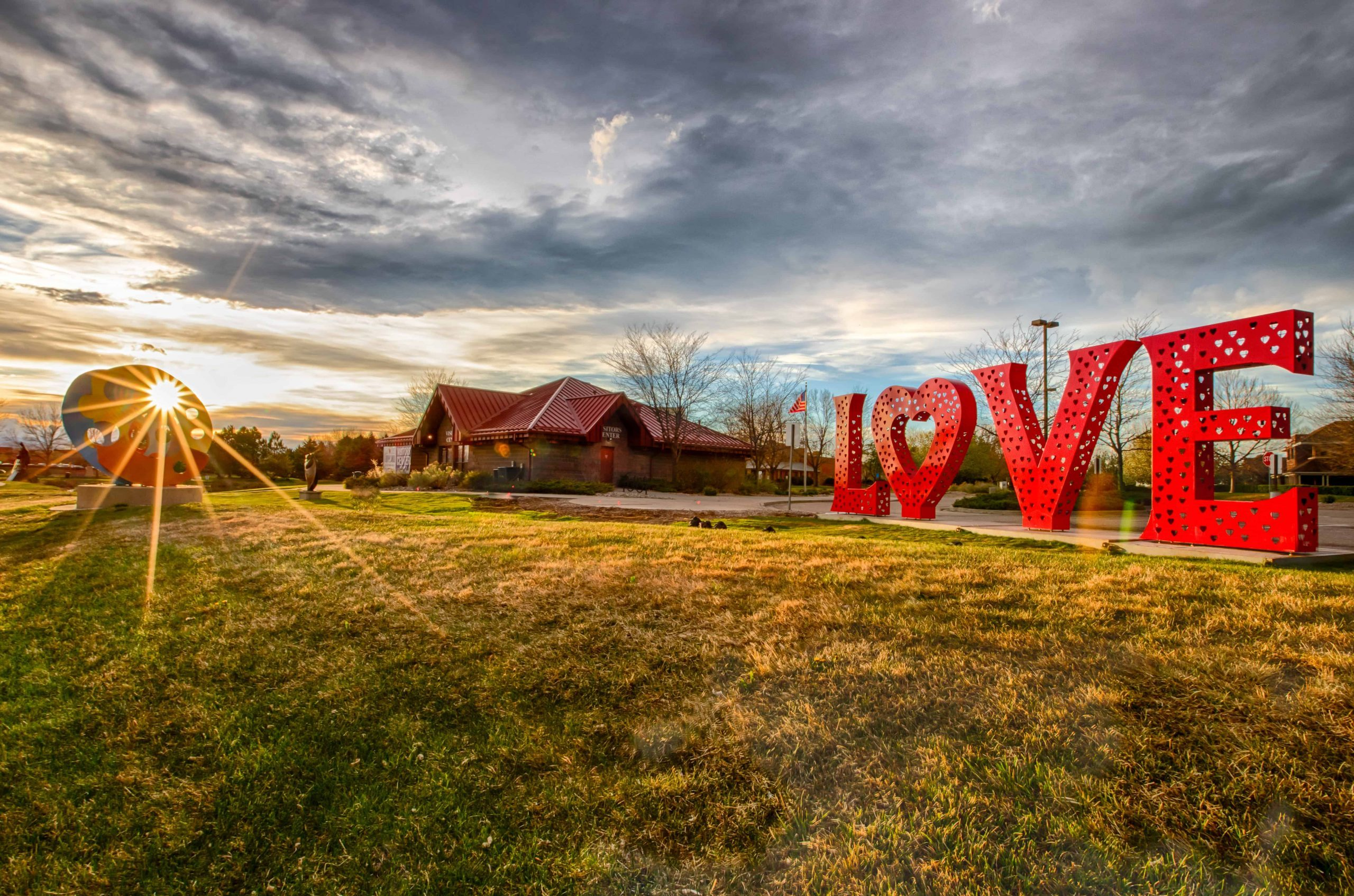 The LOVE love locks sculpture at the Visitors Center in Loveland, Colorado is one of the largest in the nation. Pose for pictures, or lock your love lock on the back. This is one of two love lock sculptures in the nation's Sweetheart City.