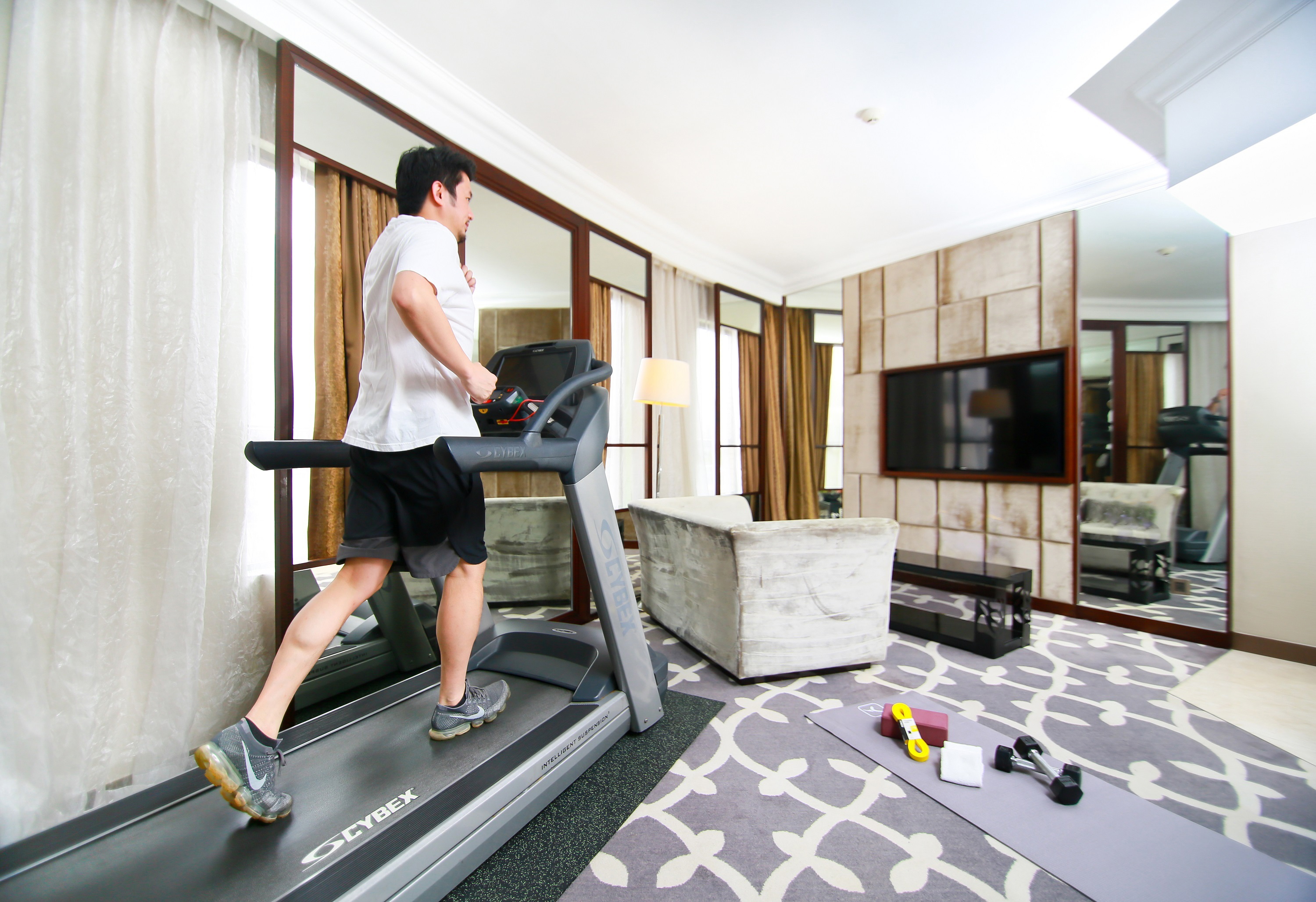 Dorsett Wanchai's Fitness Suite features in-suite treadmill and yoga set