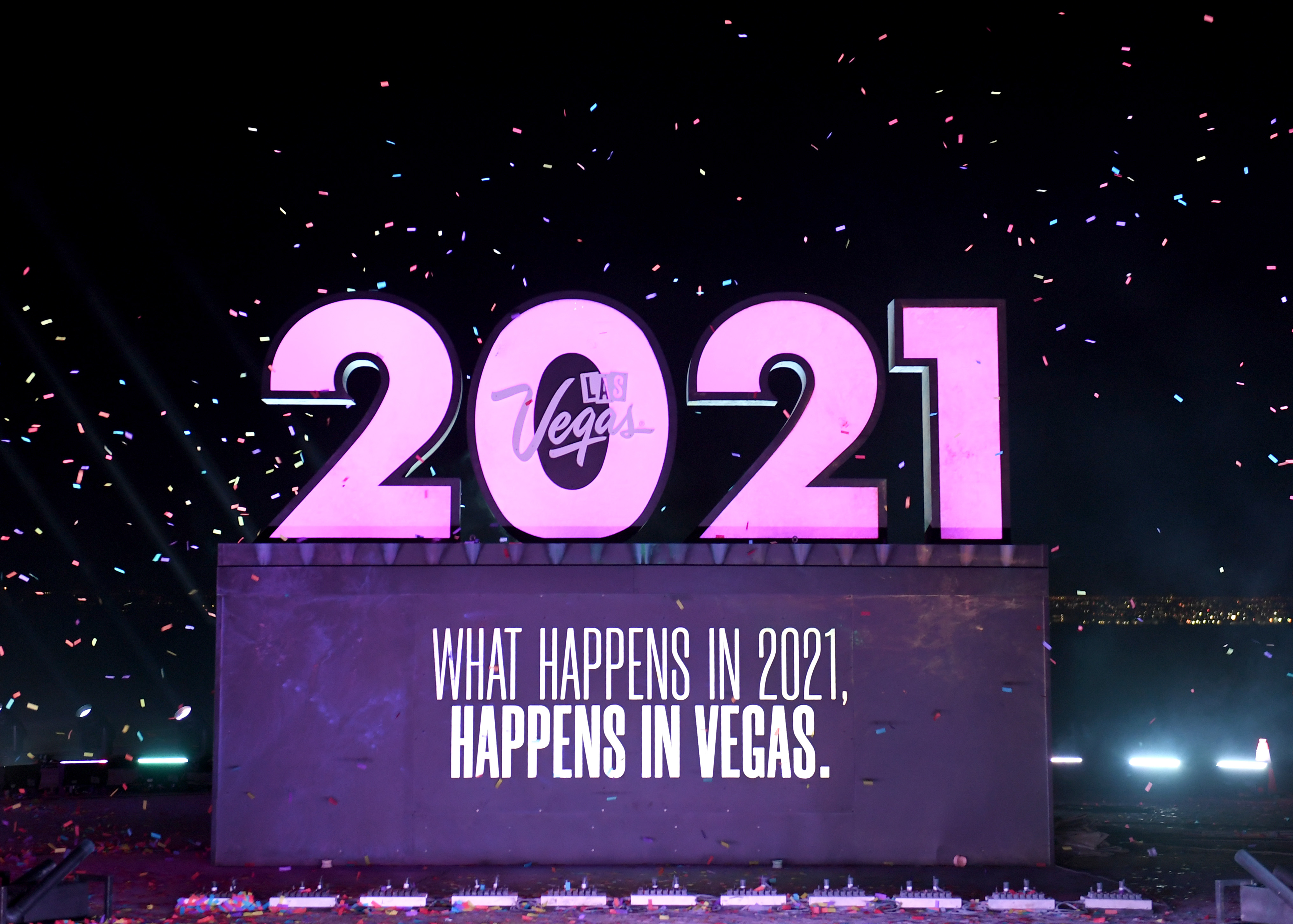 """LAS VEGAS, NEVADA – DECEMBER 31: Las Vegas Tells 2020 to """"Kiss Off"""" with a virtual event featuring an exploding 2020 sign, a fireworks display and the reveal of a 2021 sign at the Las Vegas Motor Speedway on December 31, 2020 in Las Vegas, Nevada. (Photo by Ethan Miller/Getty Images for LVCVA)"""