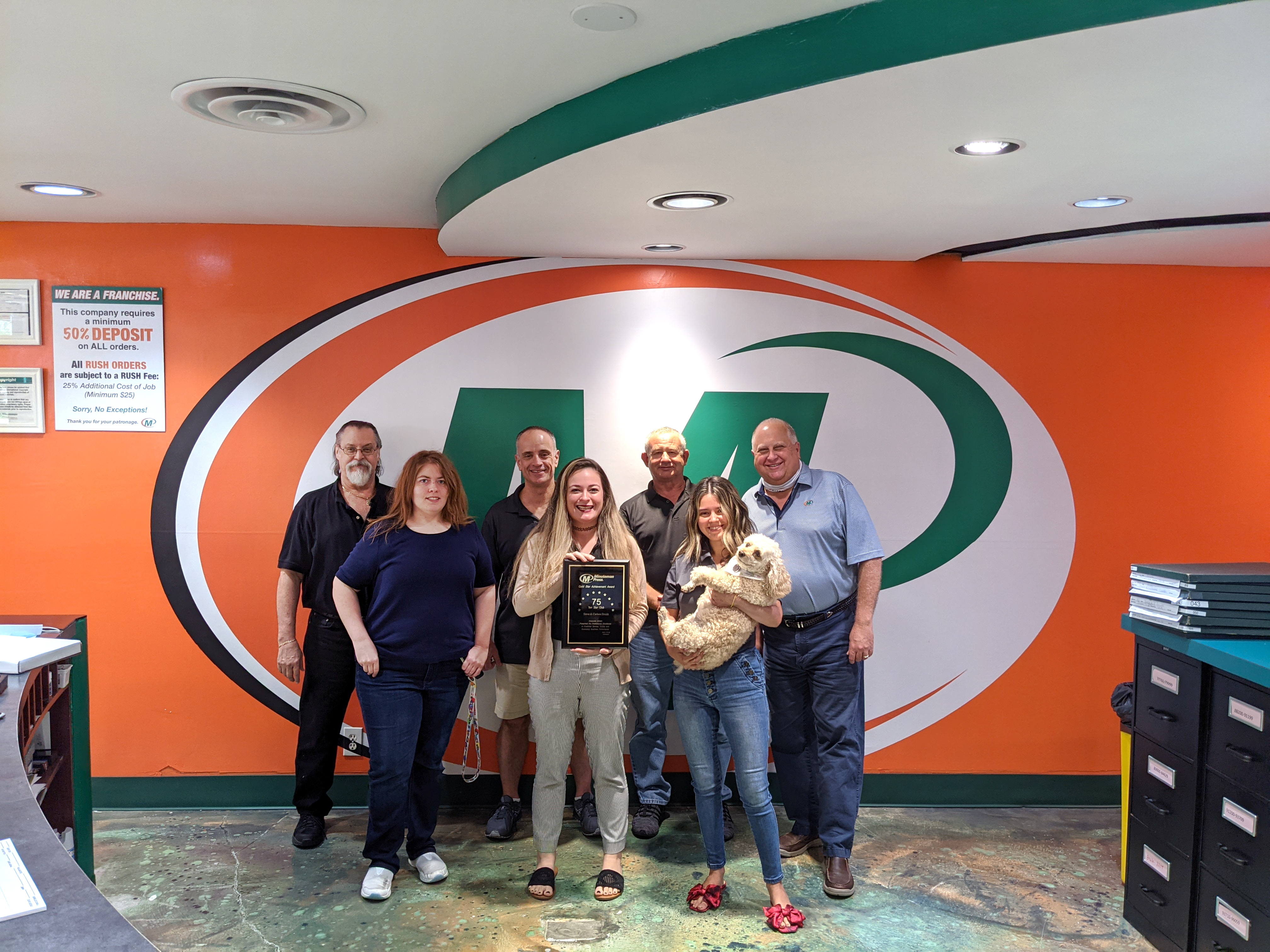 Steve Brunk (right) and the team of Minuteman Press, Port St. Lucie, FL.