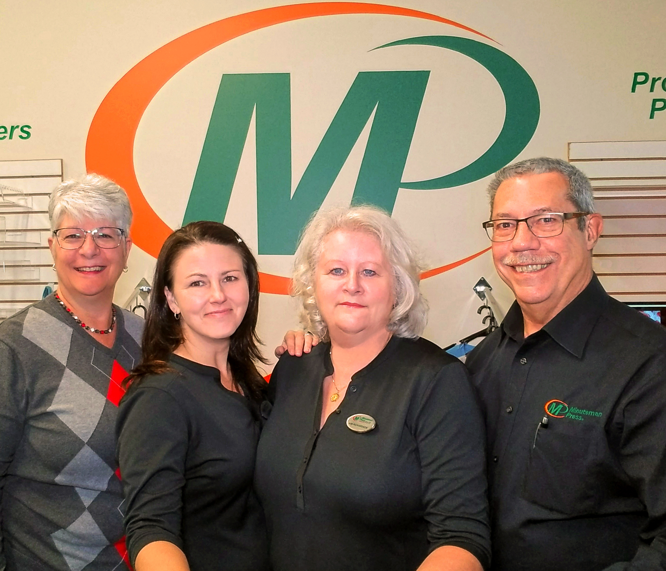 Minuteman Press printing franchise, Beaver Falls, PA – L-R: Nancy Chapple (co-owner), Tracy Hager (graphics and production manager), Kim Richardson (operations manager), and Karl Chapple (co-owner).