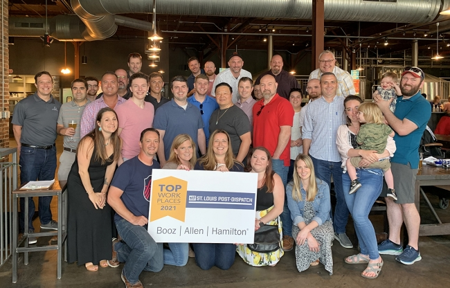 Employees of the Booz Allen St. Louis-O'Fallon Business Center celebrate being named, for the first time ever, one of 2021's <a href=https://www.stltoday.com/business/workplaces/winners-of-the-2021-top-workplaces-awards/article_e39cad0f-3092-5b50-9c17-ffa717e6f53a.html