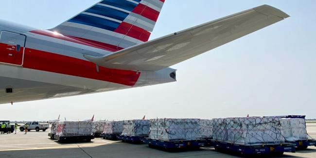 Pallets containing 3 million COVID-19 vaccine doses at Chicago O'Hare (ORD) are ready to be loaded into the cargo compartment of a Boeing 777-300 aircraft for the flight to Guatemala City (GUA).