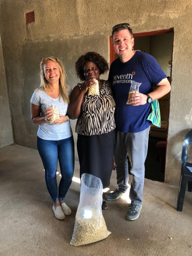Sales Manager, Katie Kowalski, on the most recent WPF Impact Trip in South Africa with a local macadamia nut seller who received a loan from WPF microfinance partner Small Enterprise Foundation.