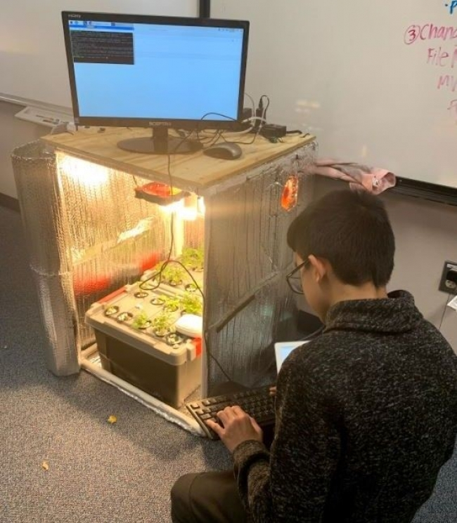 A student works on altering the growing environment on the food computer through code. Photo courtesy of Arizona Sustainability Alliance.